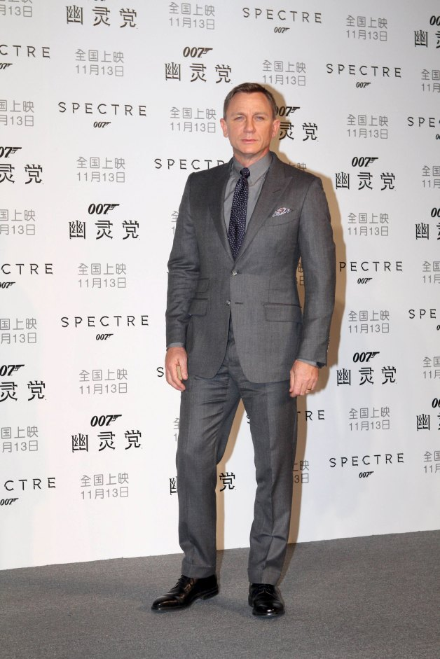 "Cast member Daniel Craig poses for pictures during a promotion event for the new James Bond 007 film ""Spectre"" in Beijing, November 10, 2015. Picture taken November 10, 2015. REUTERS/Stringer CHINA OUT. NO COMMERCIAL OR EDITORIAL SALES IN CHINA"